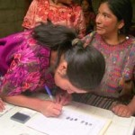 Signing for a Microloan, Guatemala
